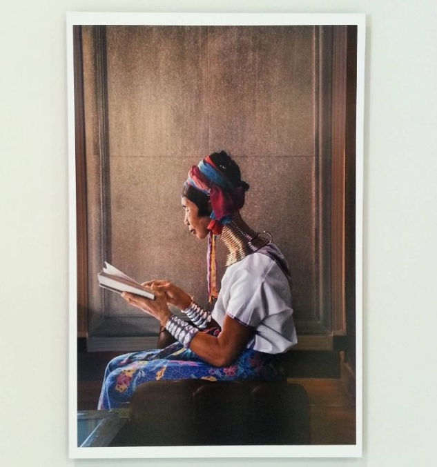 Woman reading by the window