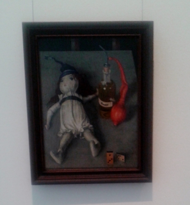 the doll with fixative bottle-wacker