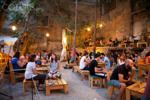 Greece – Athens – People at Six Dogs a trendy bar in the Monastiraki area