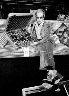 elton john with his sunglasses collection