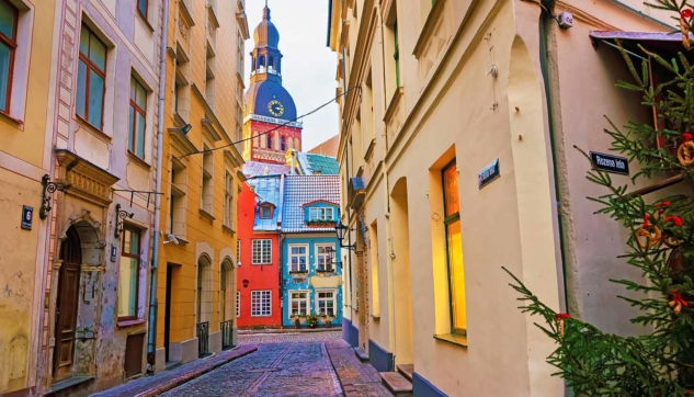 Narrow street leading to St. Peter church in Old Riga