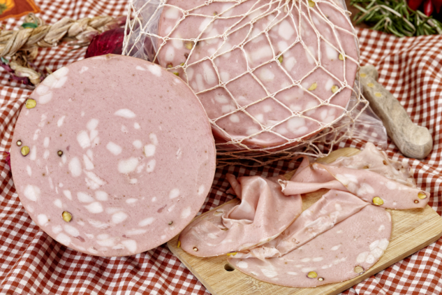 Italian mortadella on red napkin