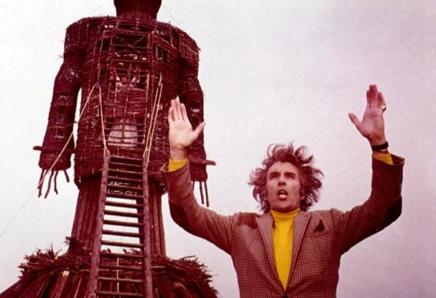 wicker-man-the-1973-013-christopher-lee-hands-aloft-before-wicker-man